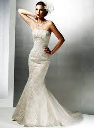Google Image Result for http://petticoatsandpistols.com/wp-content/uploads/2008/02/j1091lumermaid-wedding-dress.jpg