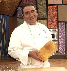 Emeril posing on the set of his show